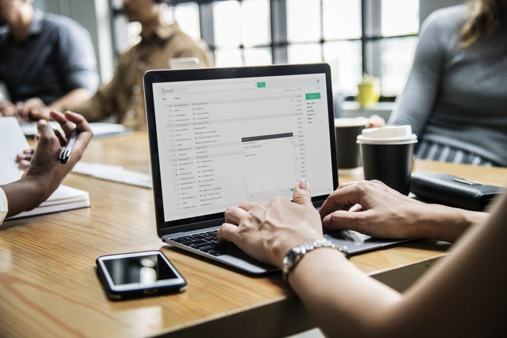 woman updating resume on laptop